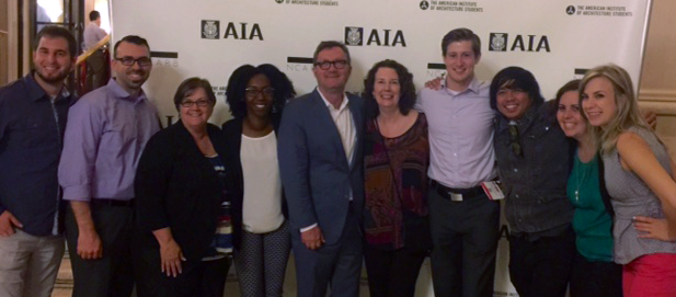 Lanny McIntosh and his wife Becki stand with EPs from The McIntosh Group at AIA Convention 2016